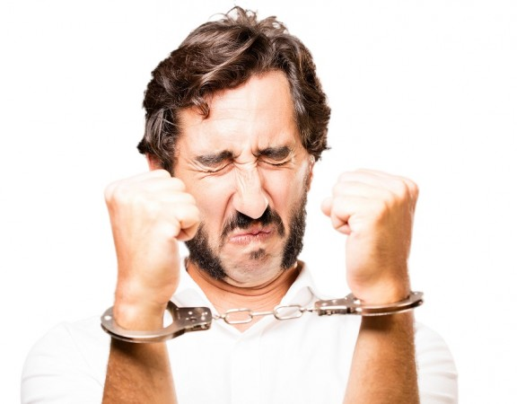 young cool man with handcuffs